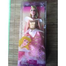Princesas Aurora (la Bella Durmiente) O Merida (valiente)