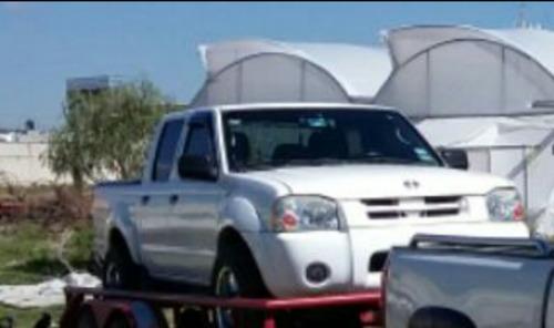 Excelente Nissan Frontier 2004