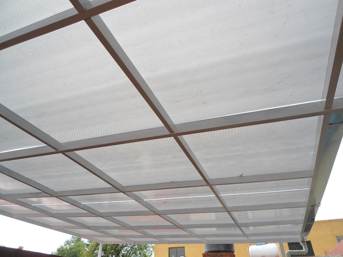 Techos de policarbonato poliacrilico garages aleros for Techos de policarbonato para garage